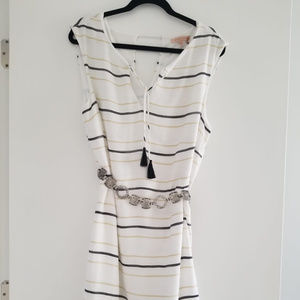 Loose fitted white dress w/ gold and black stripes